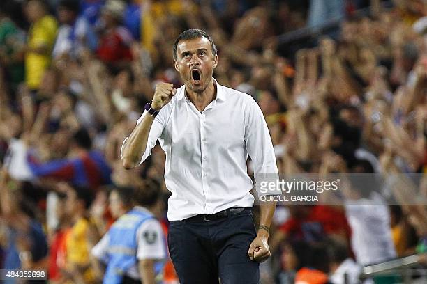 Barcelona's coach Luis Enrique celebrates a goal during the Spanish Supercup secondleg football match FC Barcelona vs Athletic Club Bilbao at the...