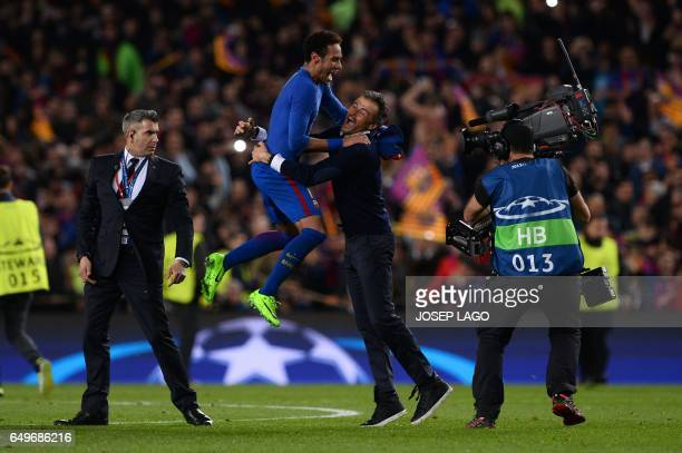 Barcelona's coach Luis Enrique celebrates with Barcelona's Brazilian forward Neymar their 61 victory at the end of the UEFA Champions League round of...