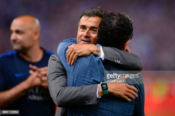 Barcelona's coach Luis Enrique is congratulated at the end of the Spanish Copa del Rey final football match FC Barcelona vs Deportivo Alaves at the...
