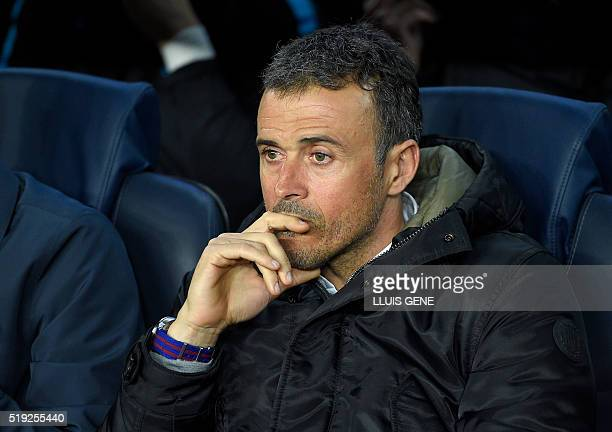 Barcelona's coach Luis Enrique looks at his players from the bench during the UEFA Champions League quarter finals first leg football match FC...