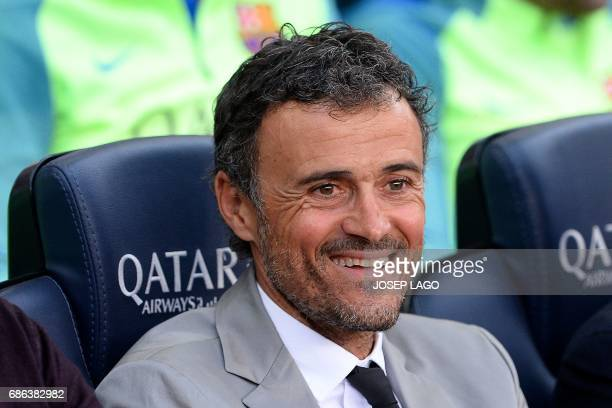 Barcelona's coach Luis Enrique sits on the bench before the Spanish league football match FC Barcelona vs SD Eibar at the Camp Nou stadium in...