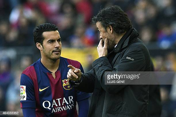 Barcelona's coach Luis Enrique talls with Barcelona's forward Pedro Rodriguez during the Spanish league football match FC Barcelona vs Malaga CF at...