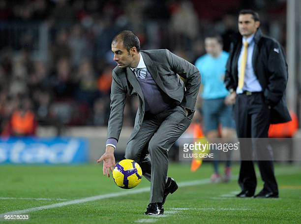 Barcelona's coach Pep Guardiola catches a ball under the look of Villarreal's coach Ernesto Valverde during their Spanish football League match on...