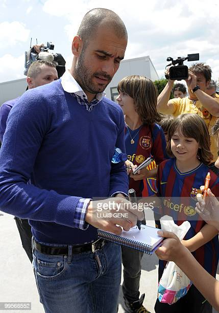 FC Barcelona's coach Pep Guardiola signs autographs after giving a press conference on May 15 at the FC Bacelona Joan Gamper sports center in...