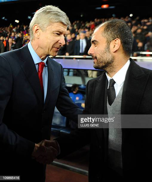 Barcelona's coach Pep Guardiola welcomes Arsenal's French coach Arsène Wenger before the Champions League round of 16 second leg football match FC...