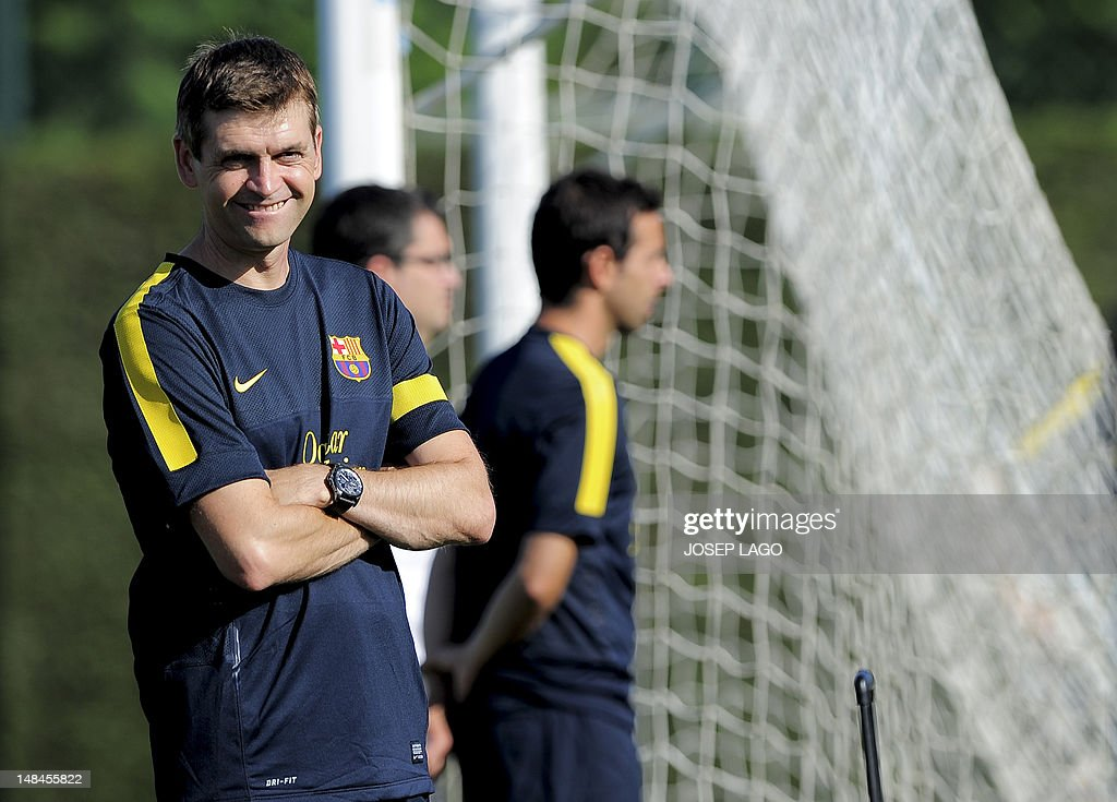Barcelona's coach <a gi-track='captionPersonalityLinkClicked' href=/galleries/search?phrase=Tito+Vilanova&family=editorial&specificpeople=5807709 ng-click='$event.stopPropagation()'>Tito Vilanova</a> smiles during the first training session of the 2012-2013 football season, on July 17, 2012, at the Sports Center FC Bacelona Joan Gamper, in San Juan Despi, near Barcelona.
