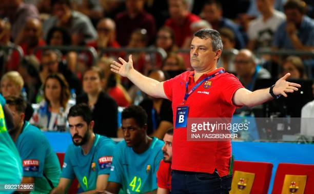 Barcelona's coach Xavi Pascual Fuertes reacts during Handball EHF Champions League final Four match for the third place between Telekom Veszprem and...