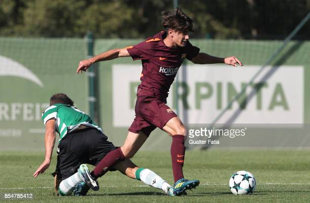 Barcelona's Collado with Sporting CP Miguel Luis in action during the UEFA Youth League match between Sporting CP and FC Barcelona at CGD Stadium...