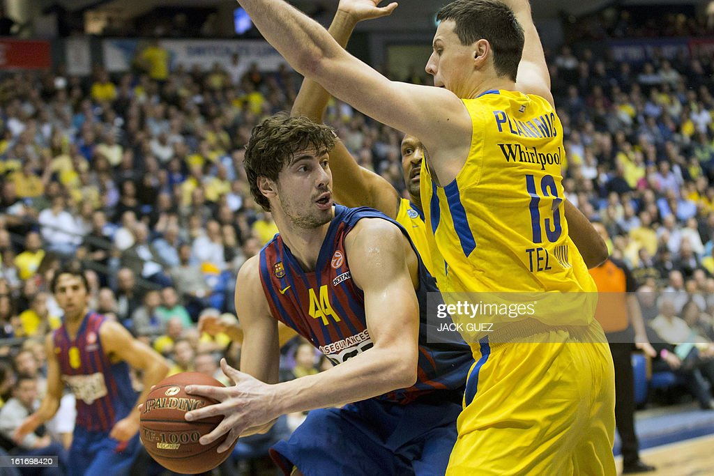 Barcelona's Croatian center Ante Tomic (L) vies with Tel Aviv's Georgia center Giorgi Shermadini (R) during their Euroleague Top 16 basketball match, Maccabi Tel Aviv Electra versus FC Barcelona Regal, on February 14, 2013 at the Nokia stadium in the Mediterranean coastal city of Tel Aviv, Israel.