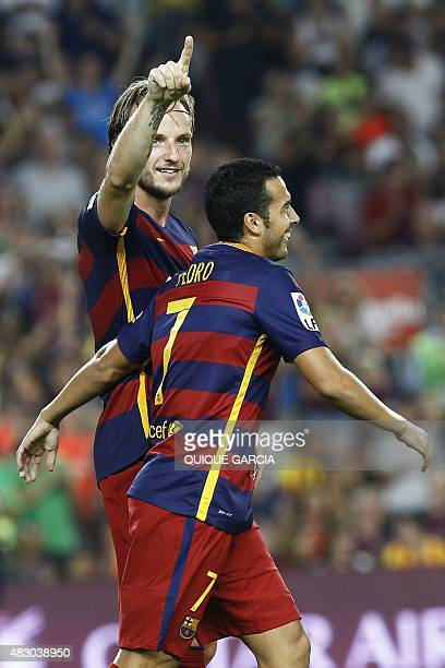 Barcelona's Croatian midfielder Ivan Rakitic celebrates his goal with Barcelona's forward Pedro Rodriguez during the 50th Joan Gamper Trophy football...