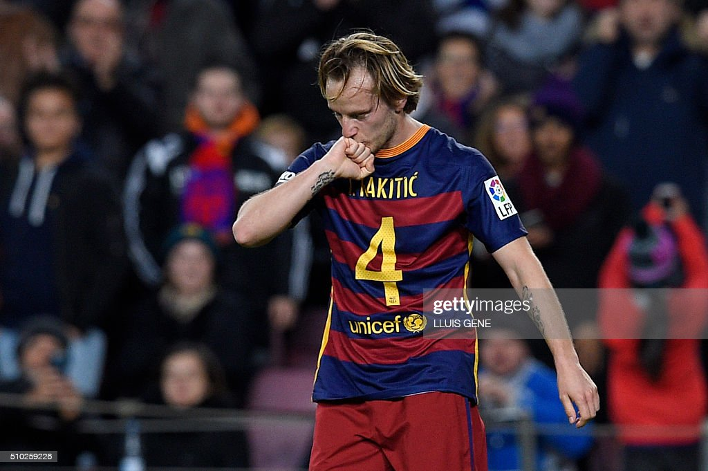 Barcelona's Croatian midfielder Ivan Rakitic kisses his fist to celebrate a goal during the Spanish league football match FC Barcelona vs RC Celta de Vigo at the Camp Nou stadium in Barcelona on February 14, 2016. GENE