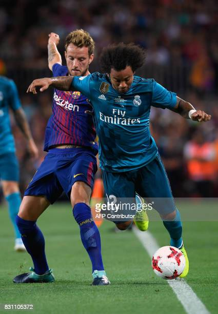 Barcelona's Croatian midfielder Ivan Rakitic vies with Real Madrid's Brazilian defender Marcelo during the Spanish Supercup first leg football match...