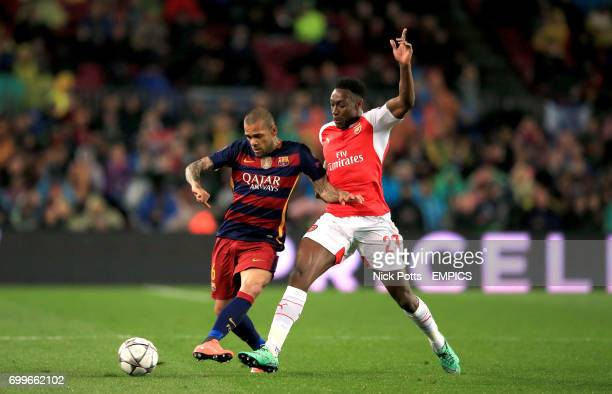 Barcelona's Dani Alves and Arsenal's Danny Welbeck battle for the ball