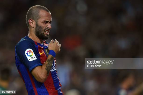 Barcelona's defender Aleix Vidal gestures during the Spanish league football match FC Barcelona vs Deportivo Alaves at the Camp Nou stadium in...