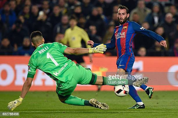 Barcelona's defender Aleix Vidal vies with Real Sociedad's Argentinian goalkeeper Geronimo Rulli during the Spanish Copa del Rey quarter final second...