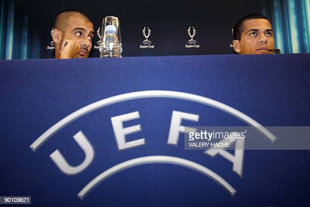 Barcelona's defender Dani Alves and coach Josep Guardiola speak during a press conference on the eve of their European Super Cup football match FC...