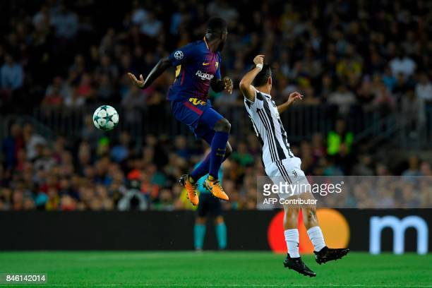 Barcelona's defender from France Samuel Umtiti vies with Juventus' forward from Argentina Paulo Dybala during the UEFA Champions League Group D...