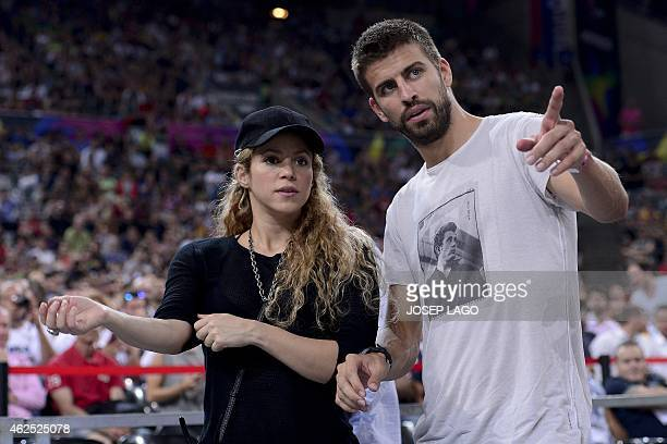 FC Barcelona's defender Gerard Pique and his wife Colombian singer Shakira attend the 2014 FIBA World basketball championships quarterfinal match...