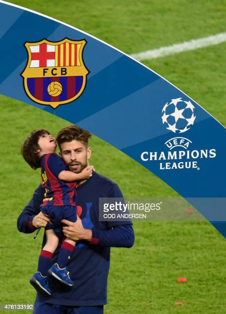 Barcelona's defender Gerard Pique carries his son Milan after the UEFA Champions League Final football match between Juventus and FC Barcelona at the...