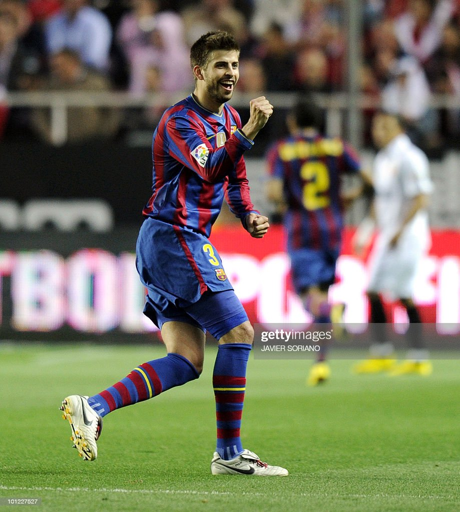 Barcelona's defender Gerard Pique celabrates after teammate Barcelona's forward Bojan Krkic scored Barcelona's second goal during their Spanish league football match beetwen Sevilla and Barcelona at Sanchez Pizjuan stadium in Sevilla on May 8, 2010.