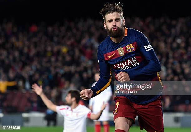 Barcelona's defender Gerard Pique celebrates a goal during the Spanish league football match FC Barcelona vs Sevilla FC at the Camp Nou stadium in...