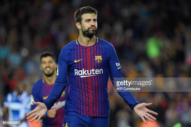 Barcelona's defender Gerard Pique celebrates after scoring during the Spanish Liga football match Barcelona vs Espanyol at the Camp Nou stadium in...
