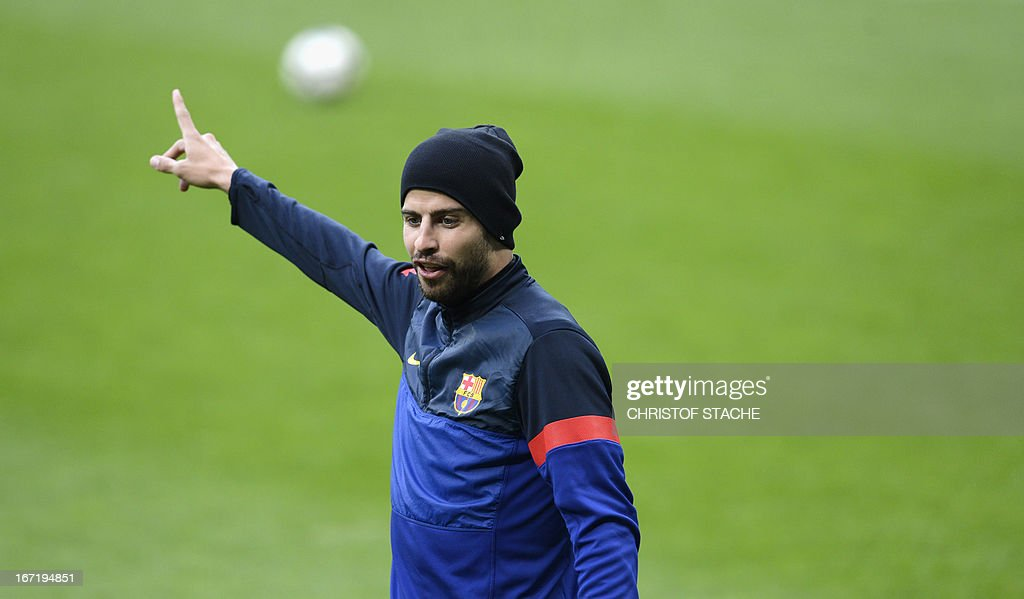 Barcelona's defender Gerard Pique gestures during the final team training on the eve of the UEFA Champions League semi final first leg football match between FC Bayern Munich and FC Barcelona at the arena in Munich, southern Germany, on April 22, 2013. The semi final match will take place on April 23, 2013.