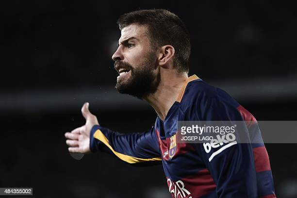 Barcelona's defender Gerard Pique gestures during the Spanish Supercup secondleg football match FC Barcelona vs Athletic club Bilbao at the Camp Nou...