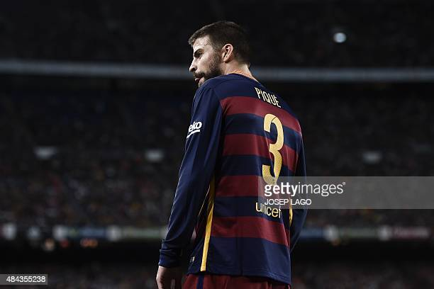 Barcelona's defender Gerard Pique is sent off during the Spanish Supercup secondleg football match FC Barcelona vs Athletic club Bilbao at the Camp...