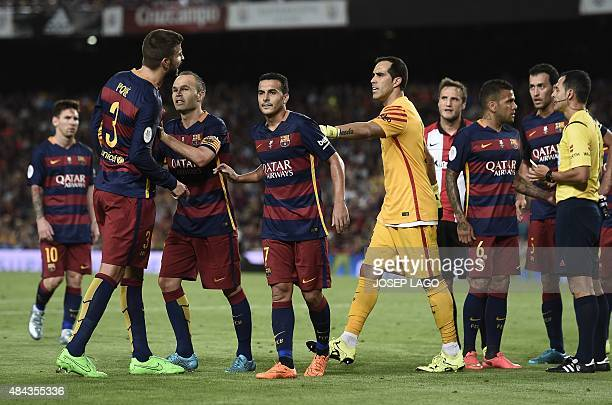 Barcelona's defender Gerard Pique reacts after being sent off during the Spanish Supercup secondleg football match FC Barcelona vs Athletic club...
