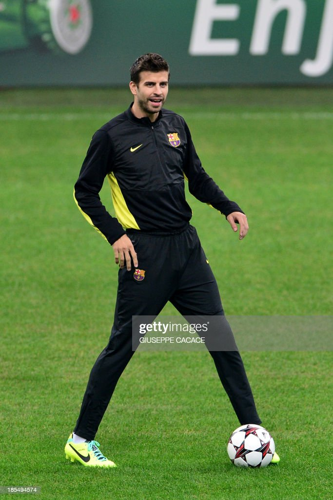 Barcelona's defender Gerard Pique takes part in a training session on October 21, 2013 in San Siro Stadium in Milan, on the eve of the UEFA Champions League football match between AC Milan and FC Barcelona.