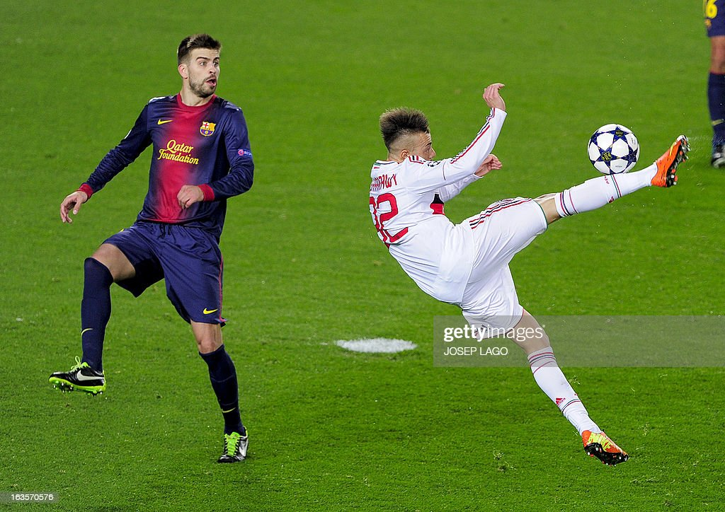 Barcelona's defender Gerard Pique (L) vies with AC Milan's forward Stephan El Shaarawy (R) during the UEFA Champions League round of 16 second leg football match FC Barcelona against AC Milan at Camp Nou stadium in Barcelona on March 12, 2013.