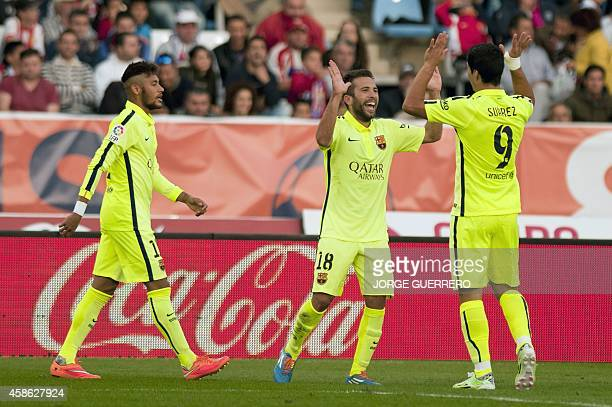 Barcelona's defender Jordi Alba celebrates after scoring with Uruguayan forward Luis Alberto Suarez during the Spanish league football match UD...