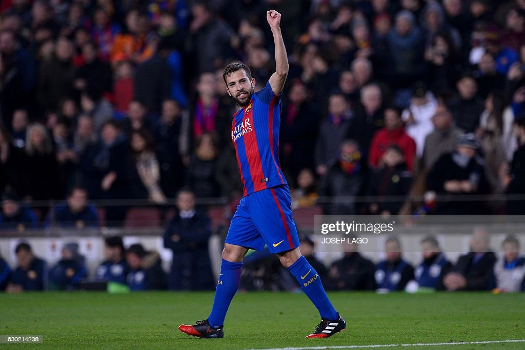 Barcelona's defender Jordi Alba celebrates his goal during the Spanish league football match FC Barcelona vs RCD Espanyol at the Camp Nou stadium in Barcelona on December 18, 2016. / AFP / JOSEP