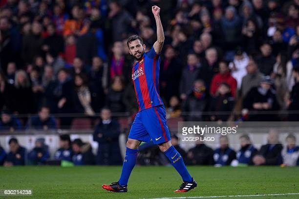 Barcelona's defender Jordi Alba celebrates his goal during the Spanish league football match FC Barcelona vs RCD Espanyol at the Camp Nou stadium in...