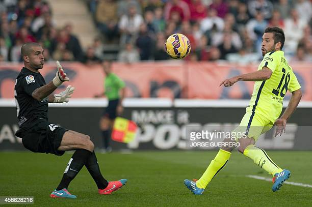Barcelona's defender Jordi Alba scores during the Spanish league football match UD Almeria vs FC Barcelona on November 8 2014 at Juegos Mediterraneos...