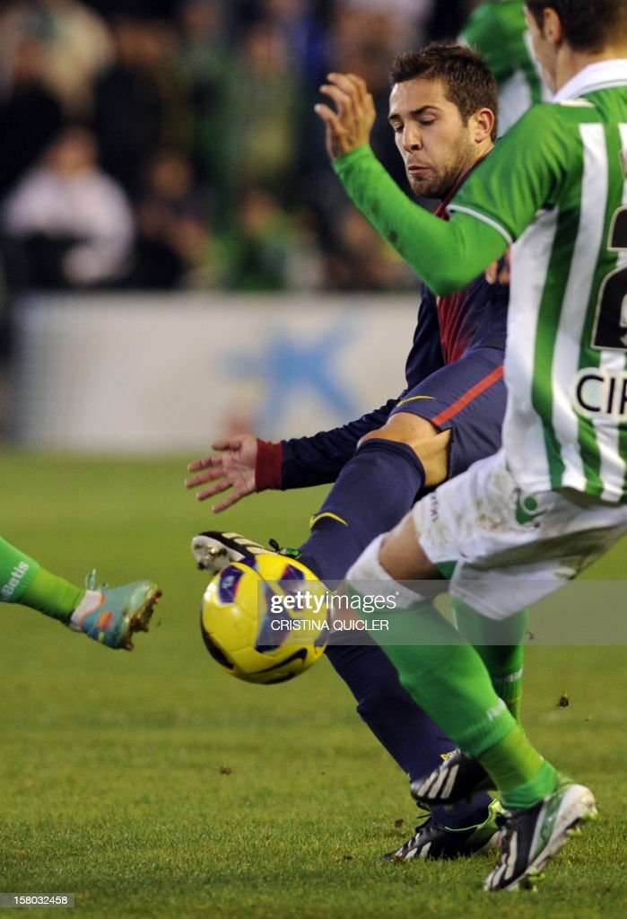 Barcelona's defender Jordi Alba (L) vies with Betis' midfielder Jose Canas (R) during the Spanish league football match Real Betis vs Barcelona at the Benito Villamarin stadium in Sevilla on December 9, 2012.AFP PHOTO/ CRISTINA QUICLER