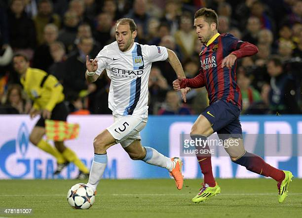 Barcelona's defender Jordi Alba vies with Manchester City's Argentinian defender Pablo Zabaleta during the UEFA Champions League round of 16 second...