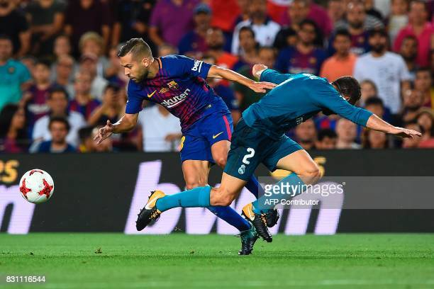 Barcelona's defender Jordi Alba vies with Real Madrid's defender Daniel Carvajal during the first leg of the Spanish Supercup football match between...