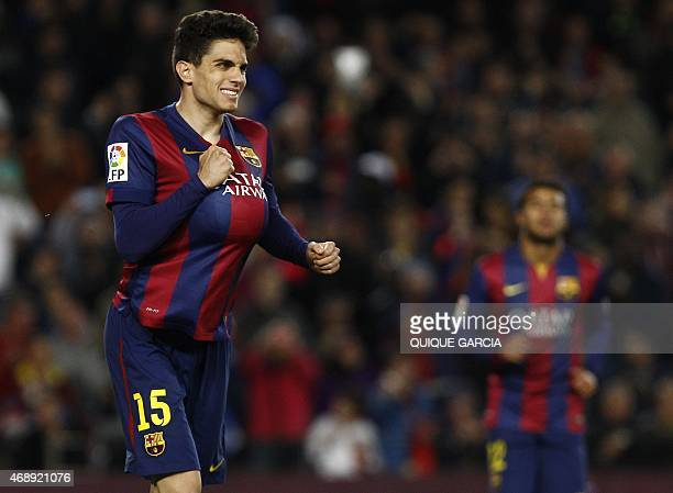 Barcelona's defender Marc Bartra celebrates a goal during the Spanish league football match FC Barcelona v UD Almeria at the Camp Nou stadium in...