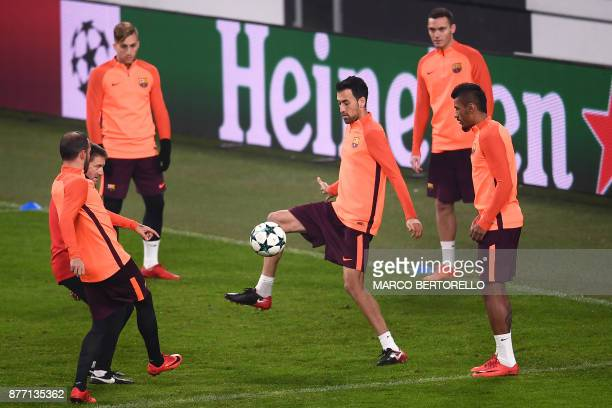 Barcelona's defender Sergio Busquets from Spain attends a training session on the eve of the UEFA Champions League football match Juventus Vs...
