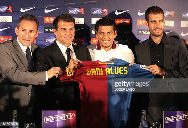 Barcelona's director of football Txiki Begiristain President Joan Laporta new signing Brasilian Dani Alves and coach Pep Guardiola pose on July 2...