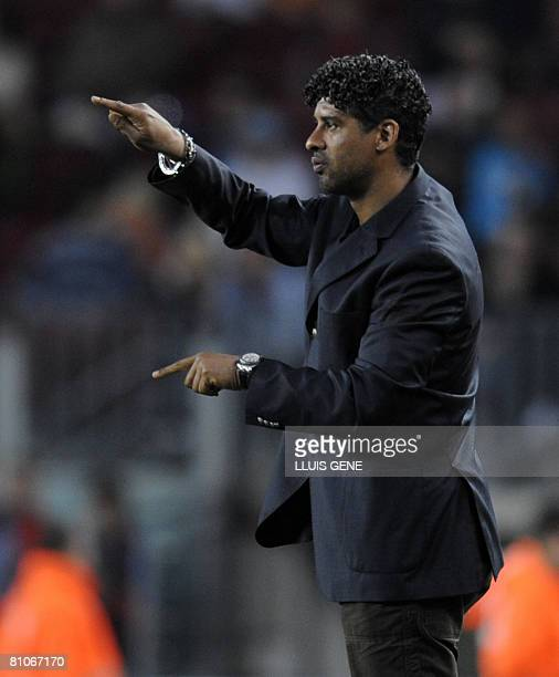 FC Barcelona's Dutch coach Frank Rijkaard gestures during their Spanish League football match against Mallorca on May 11 2008 at Camp Nou stadium in...