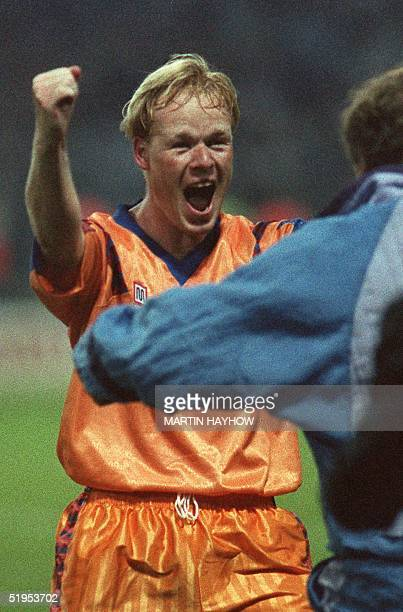 Barcelona's Dutch defender Ronald Koeman jubilates after scoring the winning goal in extra time during the European Cup final against Sampdoria Genes...