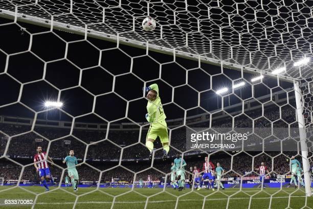 Barcelona's Dutch goalkeeper Jasper Cillessen clears a ball during the Spanish Copa del Rey semi final first leg football match Club Atletico de...
