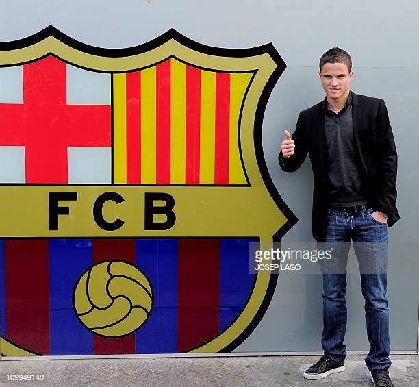 Barcelona's Dutch new recruit Ibrahim Afellay poses on December 23 2010 outside Nou Camp stadium in Barcelona after signing with the Catalan football...