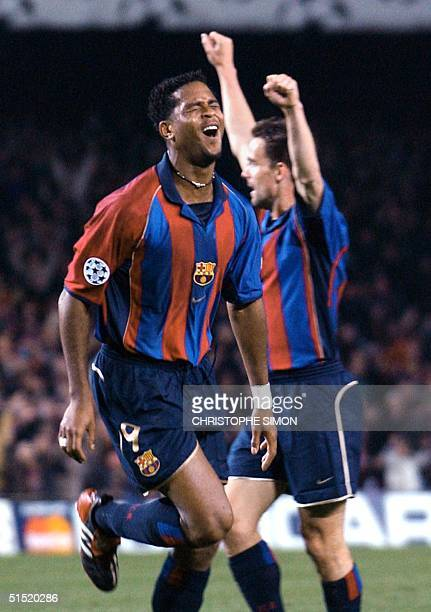 Barcelona's Dutch striker Patrick Kluivert jubilates after scoring against AS Roma during their Champions League group B soccer match at Nou Camp...