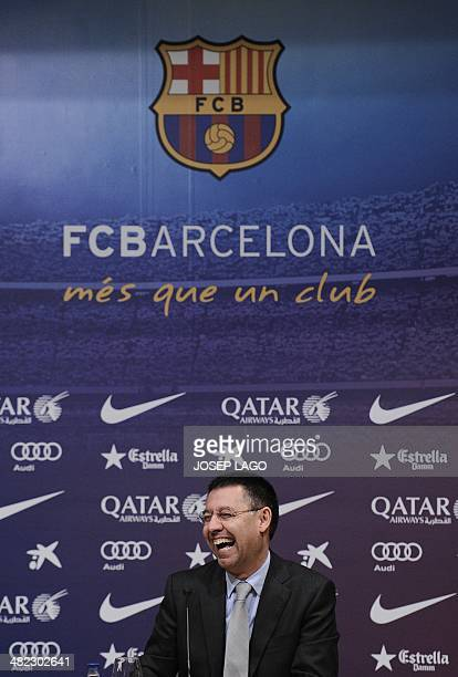 Barcelona's football club president Josep Maria Bartomeu laughs during a press conference in Barcelona on April 3 2014 at the Camp Nou stadium in...