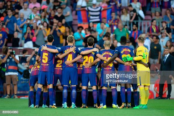 Barcelona's football players pose as they wear jerseys reading 'Barcelona' instead of their names to pay tribute to the victims of the Barcelona and...