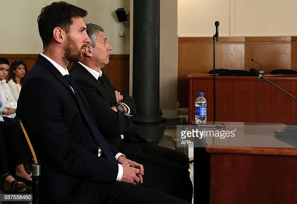 Barcelona's football star Lionel Messi and his father Jorge Horacio Messi listen as they face judges in a tax fraud case at the courthouse on June 2...
